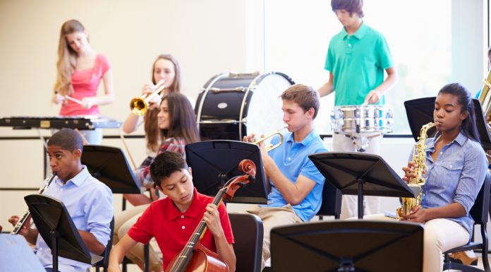 Kids with musical instruments practicing